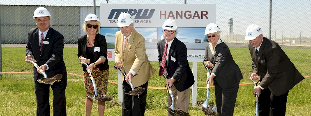 Airport & Community Officials help MPW & Renier Break Ground on new Private Hangar