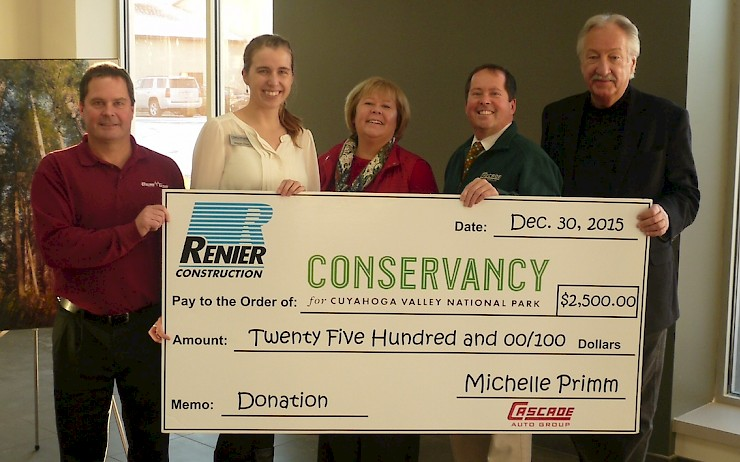 Renier Honors Client with Donation